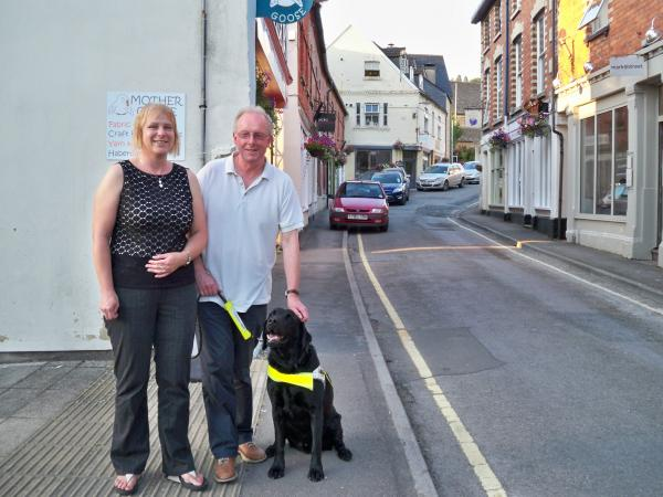 Sue Bushell with blind councillor Michael Kelly and his guide dog Jay
