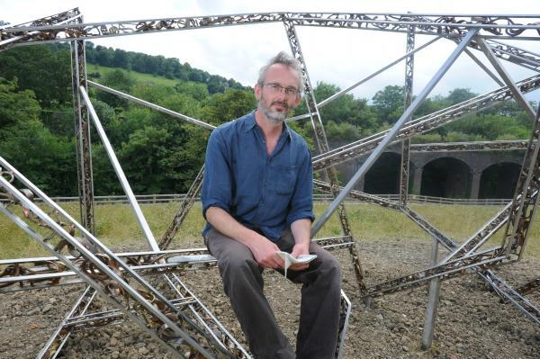 Sam Freeman with his sculpture at Capel's Mill