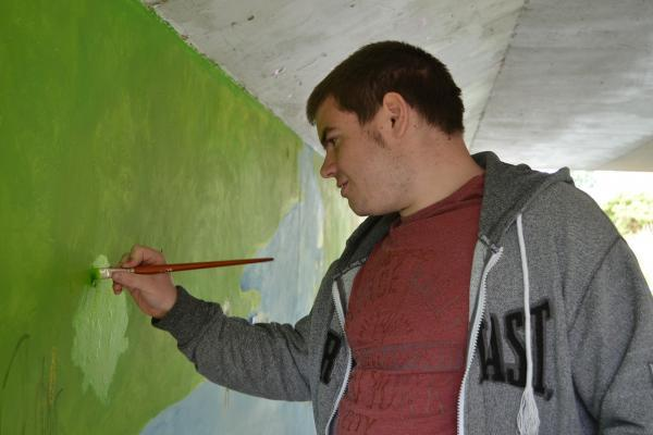 William Morris College student Jack Hodgkins was one of six pupils from the Eastington-based school to help brighten the Downton Road bridge (8447469)