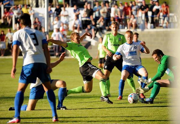 Forest Green striker Danny  Wright challenges Brimscombe defender  James Tubb and goalkeeper Adam Thomas in the fixture last summer PIC:Carl Hewlett