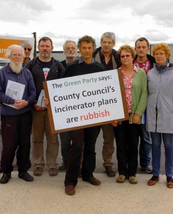 Members of the Green Party and Glosvain outside Javelin Park during a protest to stop the incinerator from going ahead. Now with just six weeks before the decision is announced protestors are demanding to know how much it is going to cost to cancel