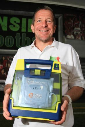 Clive Eckersall with the new defibrillator