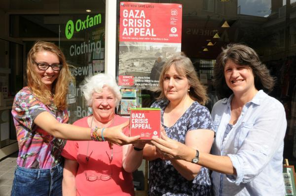 Volunteers from the Oxfam shop in Stroud (l-r) Caitlin Tilley, Jenny Wadley, Julia Trow and Dominique Shead have a collection box to help raise money for the Gaza Crisis Appeal
