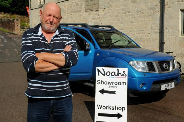 Noah's Ark owner Chris Hart and his Nissan truck which he used to block in burglars who were trying to make off with £10,000 worth of bikes from his shop in Brimscombe