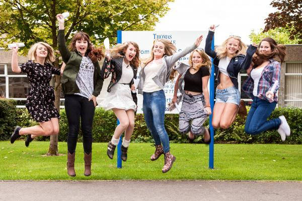 Thomas Keble School students jump for joy after collecting their GCSE results (9573438)