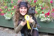 Cassie Ward from Nailsworth with Winnie the nine-month-old bulldog cross who came third in the prettiest bitch category at the Crown and Sceptre dog show