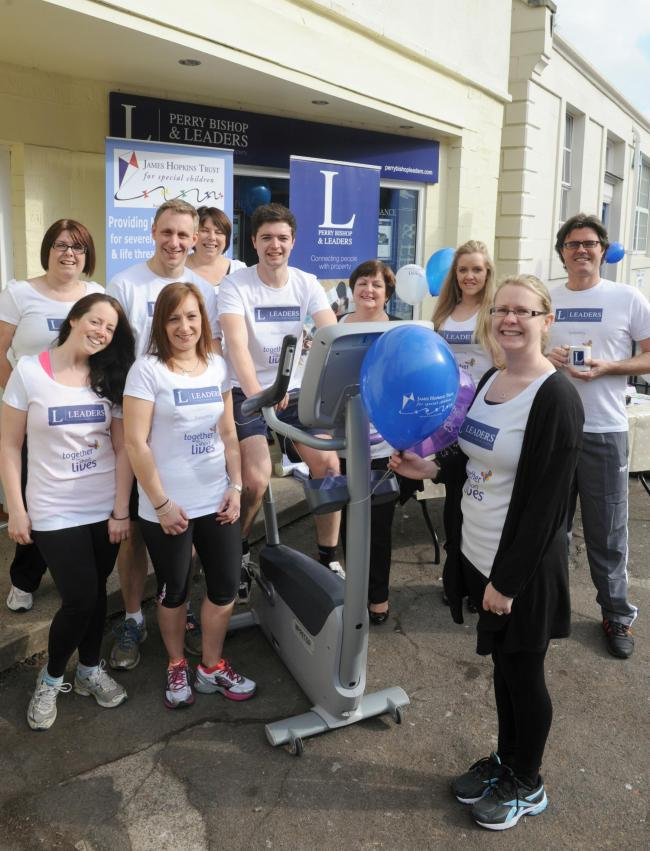 Estate agents cycle 144 miles for kids' hospice