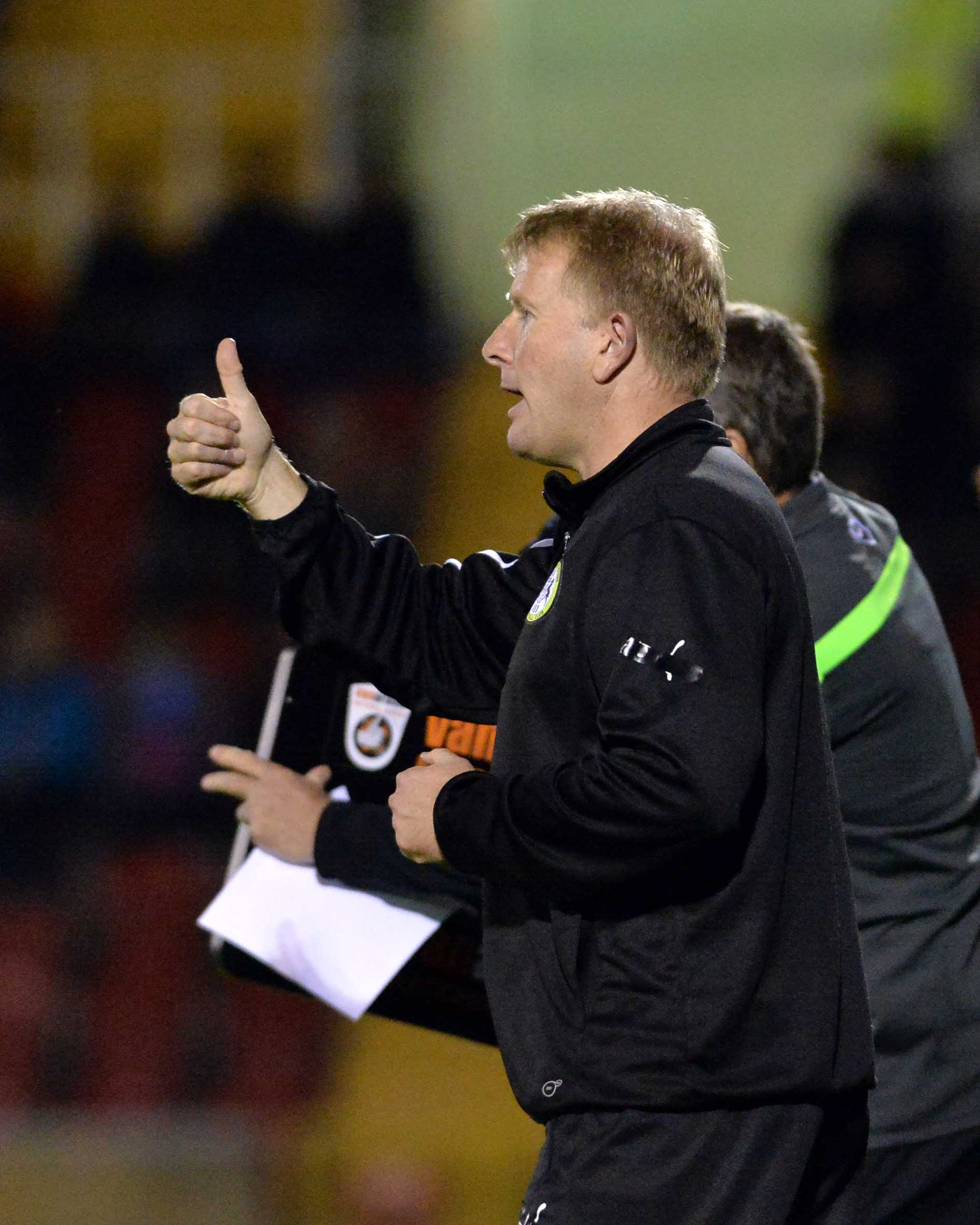 FGR boss Ady Pennock gives the thumbs-up at Woking                    Pic: Bruce Fenn