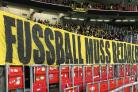 A Dortmund banner which translates as 'football has to be affordable'