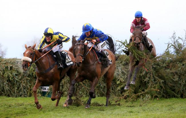 The Last Samuri, left, leads on the run-in of the 2016 Grand National from eventual third Vics Canvas with winner Rule The World on the right