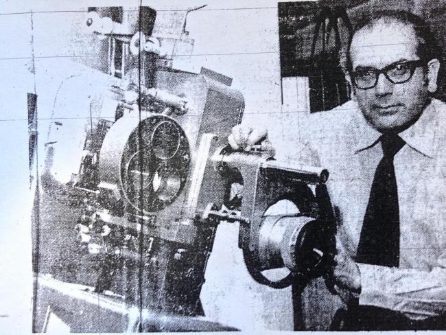 Alun Rees setting up the projection equipment at the Mecca Cinema for the final time. The Mecca closed on New Year's Eve 1976, leaving the town without a cinema. Previously the building had been a theatre for many years, it is now home to the Warehouse