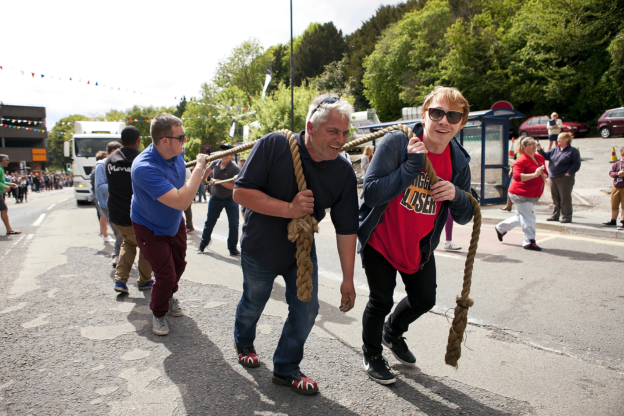 Gary Gardner (front, left) pictured with Harry Potter star Rupert Grint at the charity truck pull in Stroud in 2013. The fraud charges do not relate to events in Stroud