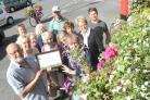 Members of Stonehouse in Bloom celebrate their silver gilt award in last year's competition