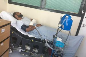 Amo Singh in hospital after he was attacked and, inset, a CCTV image of the moment a car ploughed into him