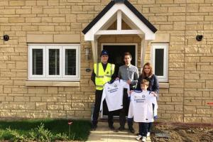 George Cole alongside Sam Dickerson, his girlfriend Gemma and their seven-year-old son Harvey with their Lioncourt kit, as they move into their new home in King's Stanley