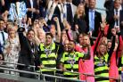 Huddersfield win penalty shoot-out against Reading to seal Premier League spot