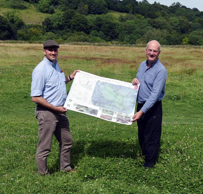 Matthew Austin, Director of Austin Design Works, and Cllr Jonathan Duckworth, Mayor of Nailsworth, with sketches for the re-design on the playing field