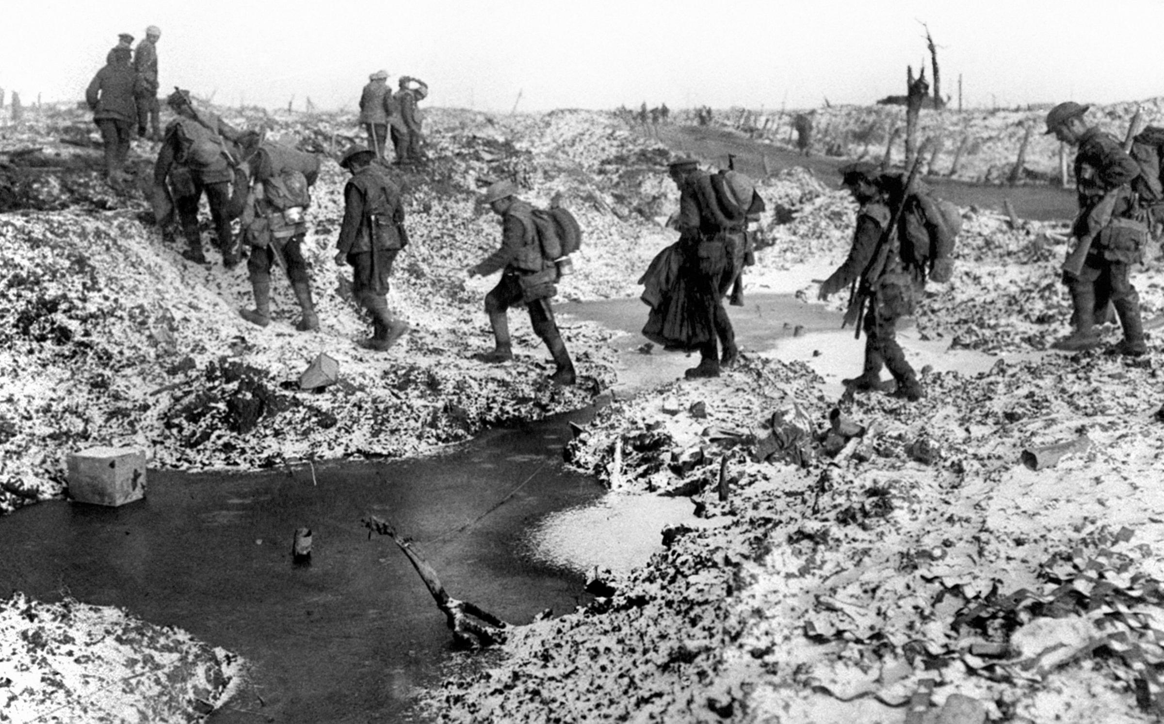 File photo of British soldiers negotiating a shell-cratered, winter landscape along the River Somme in late 1916 after the close of the Allied offensive.