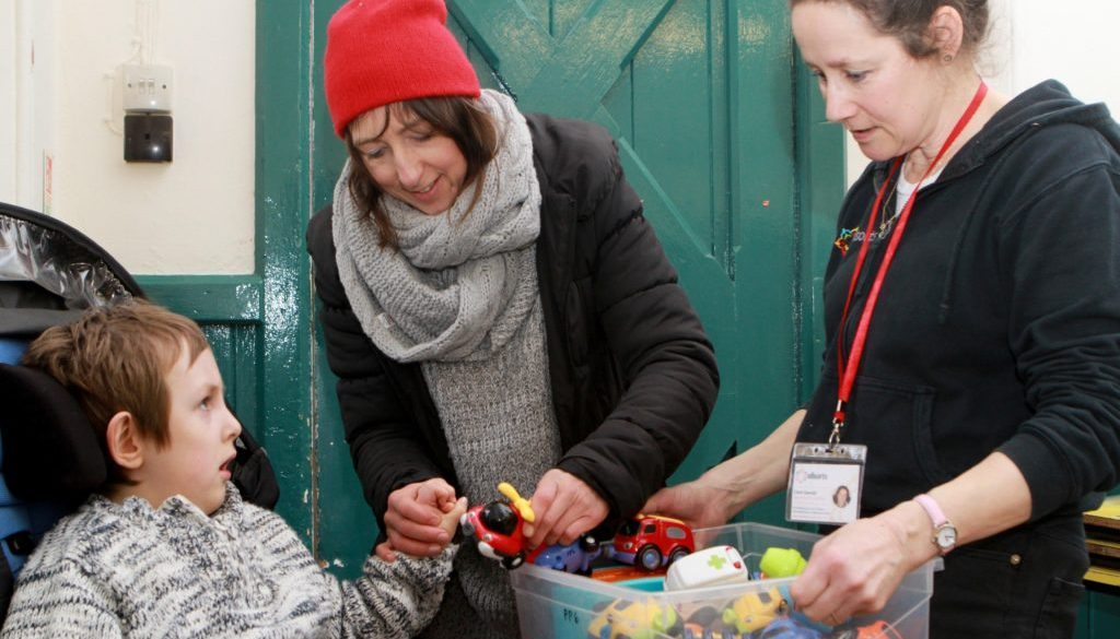 Allsorts Toy Library, Trinity Rooms, Stroud - Eloise Cole-Newton and her son Raphael, six looking through a box of toys with Clare Garratt of Allsorts - 18.03.16Picture by Carl Hewlett/TWM - Thousand Word Media Ltd, NO SALES, NO SYNDICATION. Contact for