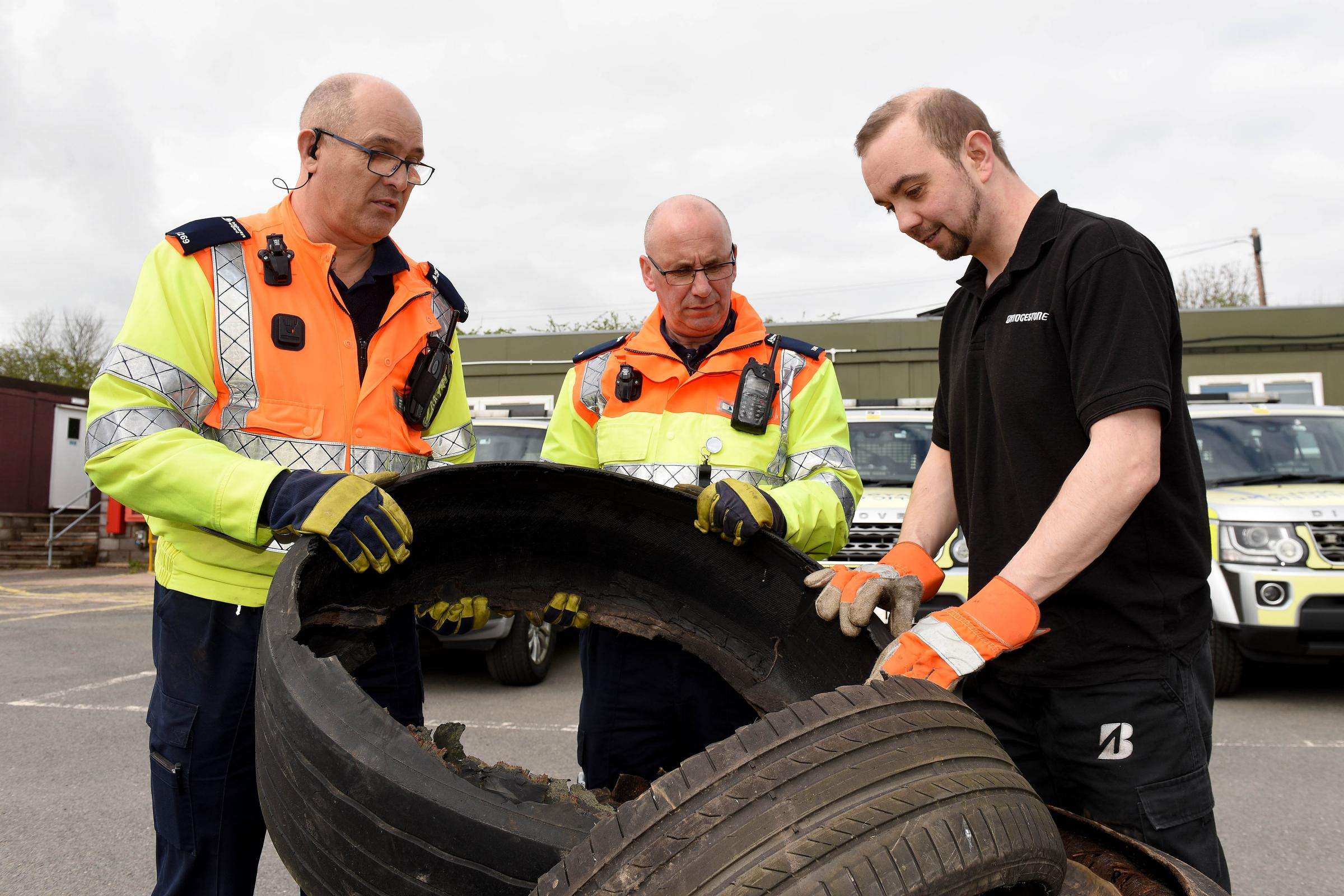 Highways England traffic officers Mark Hindhaugh and Mark Ratkovich indpecting M5 tyre debris with Bridgestone's Peter Moulding