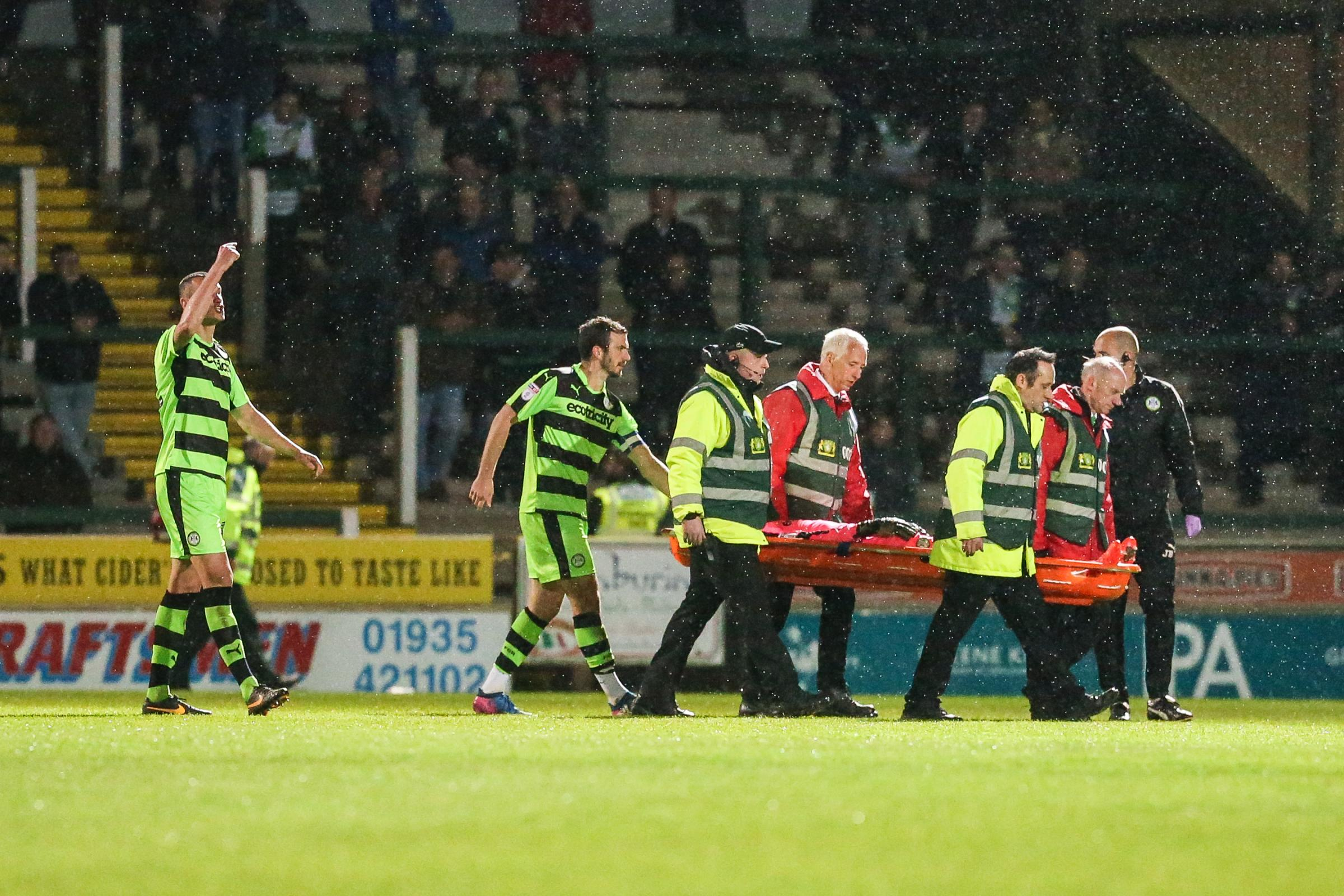 Brad Collins was stretchered off at Yeovil                Pic: Shane Healey/ Pro Sports Images