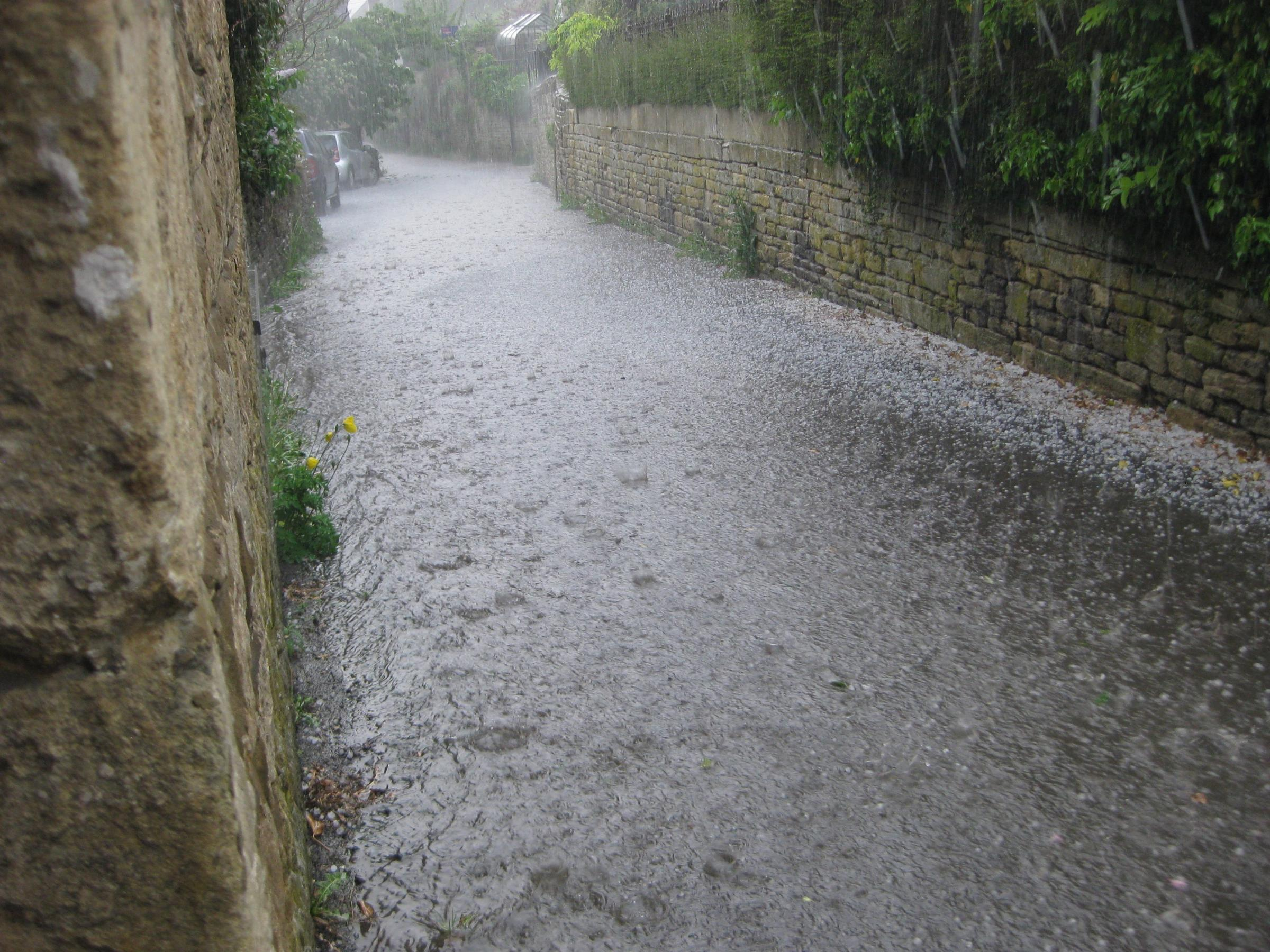 Heavy rain overflowed a manhole cover in Chalford and residents are blaming a recent road resurfacing for the failure of sewage to drain away
