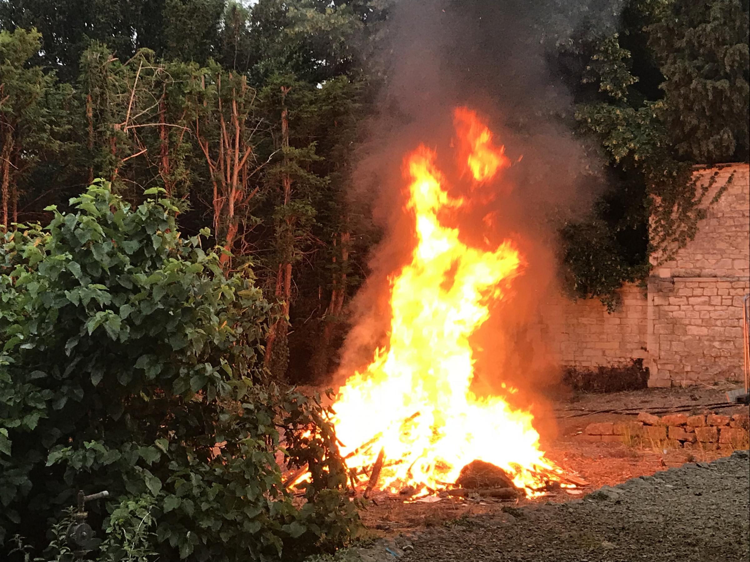 Firefighters tackle the out-of-control bonfire at the Old Convent in Stroud