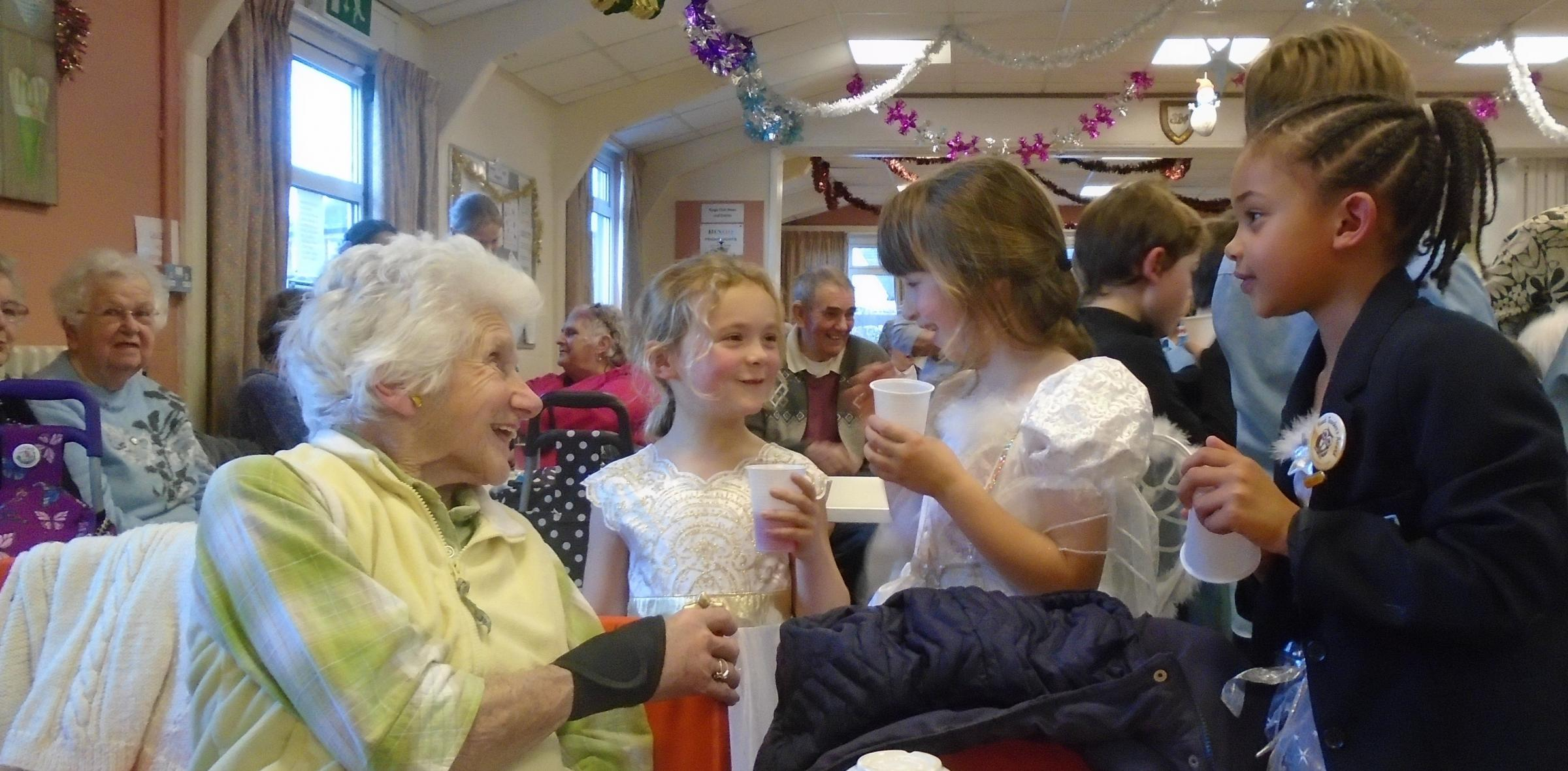 Pupils meet members of Stonehouse Pensioners Club