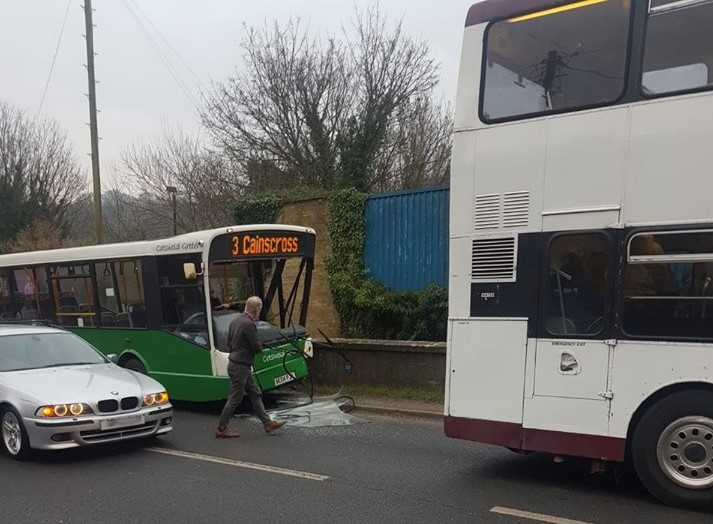 Bus crashes into wall on busy road