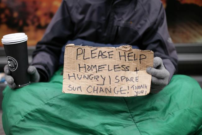 File photo dated 18/03/16 of Lucas, a homeless man, holding a sign reading 'Please help, homeless and hungry' in Victoria, London, as ministers were accused of ignoring the plight of the homeless as new figures showed a sharp rise in the number of