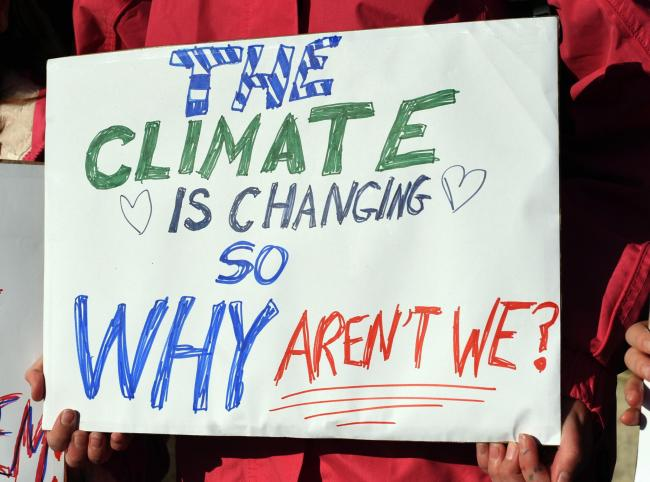 A sign from a climate change protest in Stroud last year. Photo: Simon Pizzey