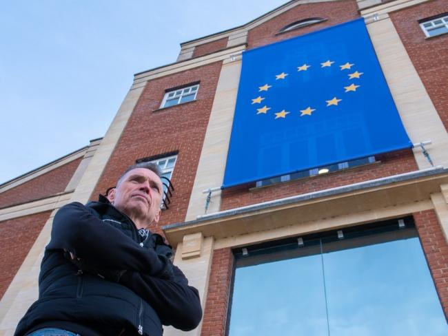 Dale Vince with the EU flag draped outside Ecotricity