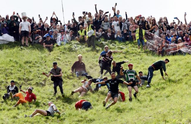 MAY  27   2019         ....PHOTOGRAPHER  COPYRIGHT SIMON PIZZEY ............CHEESE ROLLING> COOPERS HILL   GLOUCESTERSHIRE ...............